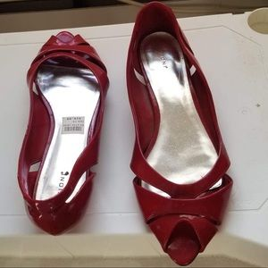 Red low heel open toe shoes